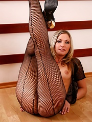 Petite blondie in fishnet tights shows off on cam