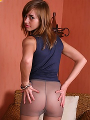 Teen with a cute smile and no panties under tights